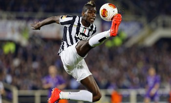 Juventus' Paul Pogba is airborne as he jumps to control the ball