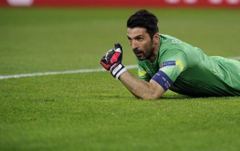 Juventus' goalkeeper Buffon reacts after a save against Monaco during their Champions League quarterfinal soccer match at the Juventus stadium in Turin