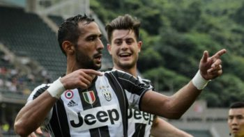 Juventus player Medhi Benatia (L) celebrates after scoring against South China during the football match between Juventus and South China at Hong Kong Stadium on July 30, 2016. / AFP / ANTHONY WALLACE (Photo credit should read ANTHONY WALLACE/AFP/Getty Images)